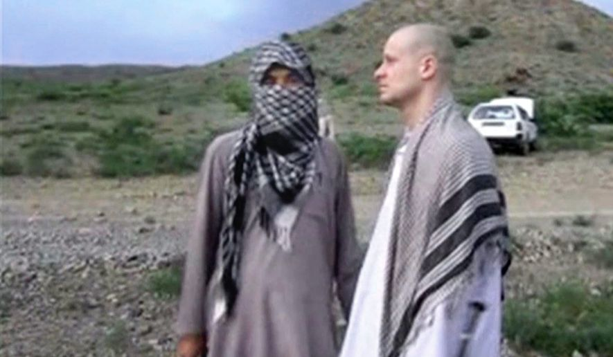 Sgt. Bowe Bergdahl, right, stands with a Taliban fighter in eastern Afghanistan. The Taliban on Wednesday, June 4, 2014, released a video showing the handover of Bergdahl to U.S. forces in eastern Afghanistan, touting the swap of the American soldier for five Taliban detainees from Guantanamo as a significant achievement for the insurgents. (Associated Press) ** FILE **