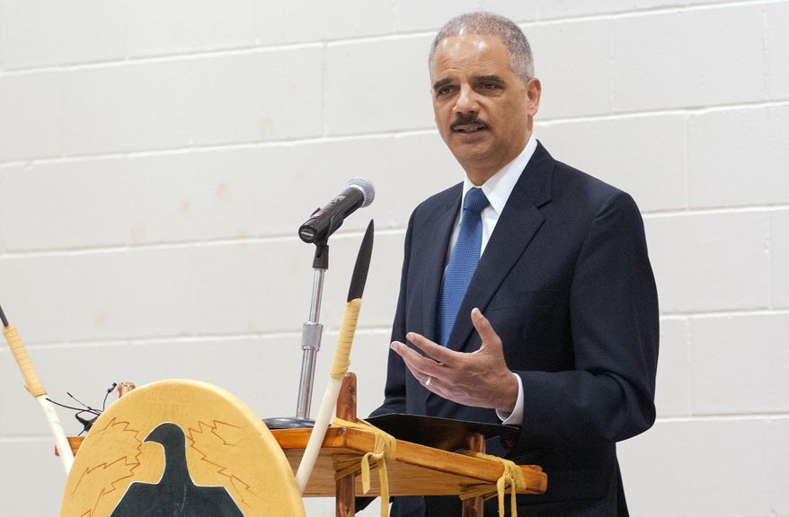 """U.S. Attorney General Eric Holder delivers his keynote address at a tribal conference on the campus of United Tribes Technical College in Bismarck, N.D., on Thursday, June 5, 2014.  Holder says the Justice Department and the Obama administration have """"fought to protect natural resources and water rights on tribal lands ... and prioritized the resolution of longstanding legal disputes."""" He says the administration also has helped tribal authorities """"combat violence against Native women.""""  (AP Photo/Kevin Cederstrom)"""