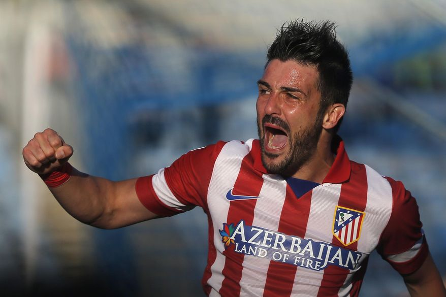 FILE - This April 13, 2014 file photo shows Atletico's  David Villa celebrating Diego Godin's goal during a Spanish La Liga soccer match between Getafe and Atletico Madrid at the Coliseum Alfonso Perez  stadium in Madrid, Spain. Villa has signed a three-year contract with New York City FC, becoming the first player on the expansion Major League Soccer team that starts play next season. (AP Photo/Andres Kudacki, File)