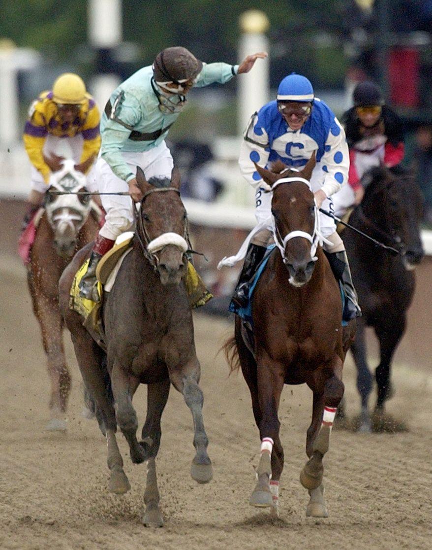 Jockey Edgar S. Prado, left, aboard Birdstone, reacts after winning the Belmont Stakes as jockey Stewart Elliott, right, aboard Smarty Jones looks on at Belmont Park, Saturday, June 5, 2004, in Elmont, N.Y. Smarty Jones finished second. (AP Photo/Frank Franklin II)