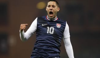 FILE - In this Feb. 29, 2012 file photo, team USA forward Clint Dempsey celebrates after scoring during a friendly soccer match against Italy in Genoa, Italy. Coming off an injury-filled summer, U.S. national soccer team star Clint Dempsey is looking forward to regaining form heading into his first World Cup as U.S. captain.  (AP Photo/Luca Bruno, File)