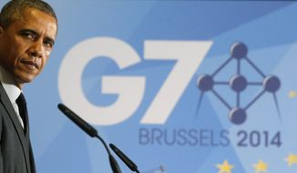 President Barack Obama listens as British Prime Minister David Cameron speaks during a news conference at the G7 summit in Brussels, Belgium, Thursday, June 5, 2014. (AP Photo/Charles Dharapak)