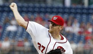 Washington Nationals starting pitcher Stephen Strasburg throws during the first inning of a baseball game against the Philadelphia Phillies at Nationals Park Wednesday, June 4, 2014, in Washington. (AP Photo/Alex Brandon)