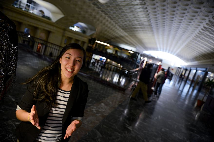 Esther Kim, manager at Fantom Comics in Union Station, Washington, D.C., Tuesday, February 11, 2014. (Andrew Harnik/The Washington Times)