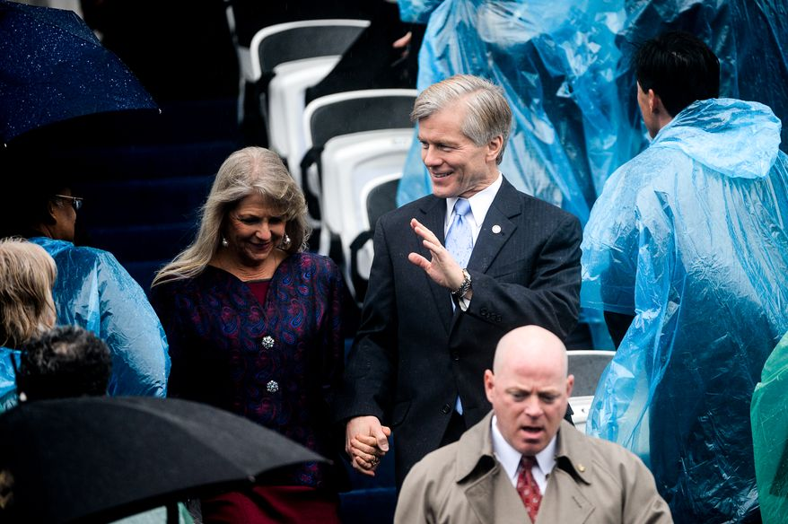 Outgoing Virginia Gov. Bob McDonnell and his wife Maureen Gardner arrive to see Terry McAuliffe sworn in as the 72nd Governor of the Commonwealth of Virginia on a very rainy day in front of the Virginia State Capitol, Richmond, Va., Saturday, January 11, 2014. (Andrew Harnik/The Washington Times)