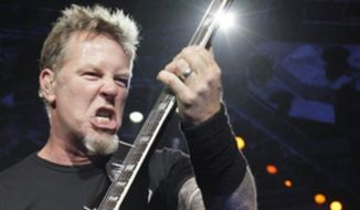 ** FILE ** Metallica'S James Hetfield performs at the World Magnetic tour in Vilnius, Lithuania, April 20, 2010. (Associated Press)