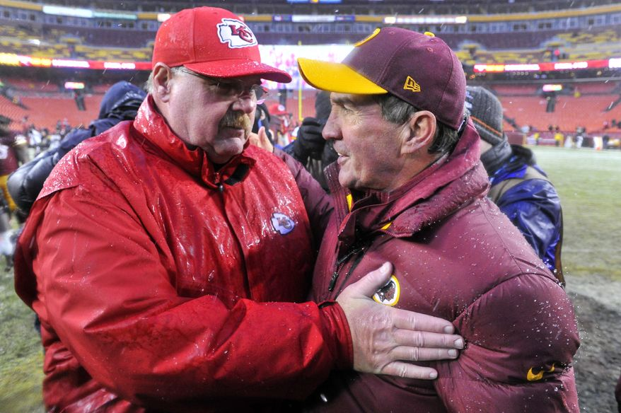 Washington Redskins head coach Mike Shanahan is met at midfield by Kansas City Chiefs head coach Andy Reid after a 45-10 loss at FedExField, Landover, Md., December 8 2013. (Preston Keres/Special for The Washington Times)