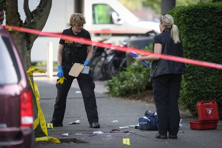 Seattle police investigate the scene after a shooting at Seattle Pacific University on Thursday, June 5, 2014, in Seattle. A lone gunman armed with a shotgun opened fire  in a building at the small Seattle university, fatally wounding one person and injuring three others before a student subdued him with pepper spray as he tried to reload, Seattle police said. (AP Photo/seattlepi.com, Joshua Trujillo) NO SALES; MAGS OUT; SEATTLE TIMES OUT SEATTLE ONLINE OUT  TV OUT