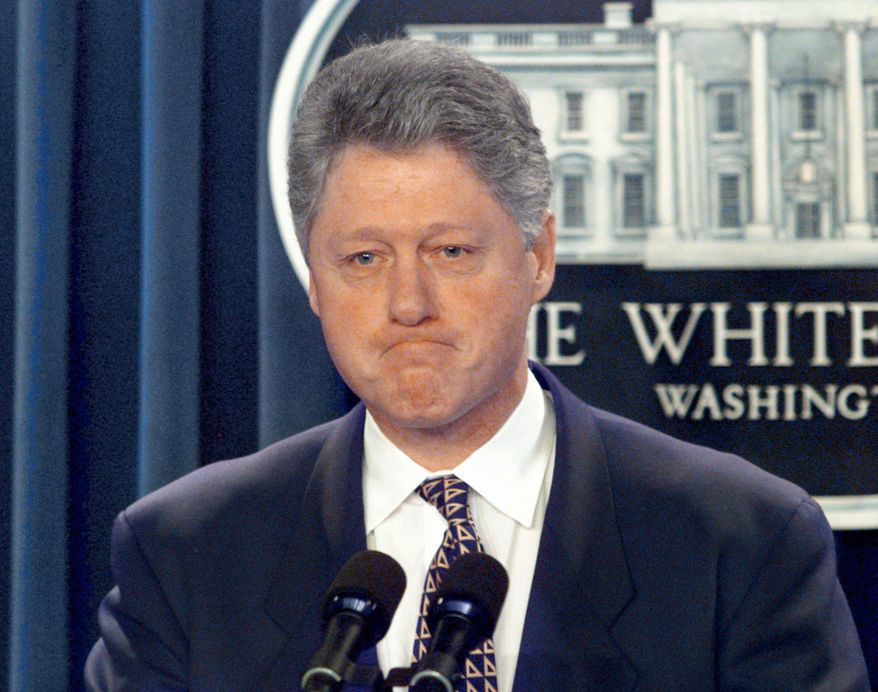 ** FILE ** Former President Bill Clinton meets reporters in the briefing room of the White House in Washington, Jan. 18, 1996. (AP Photo/Doug Mills, File)