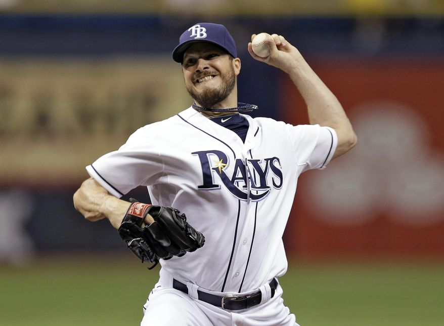 Tampa Bay Rays starting pitcher Erik Bedard delivers to the Seattle Mariners during the first inning of a baseball game Friday, June 6, 2014, in St. Petersburg, Fla. (AP Photo/Chris O'Meara)