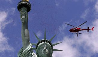 One of three helicopters showered 1-million rose petals on the Statue of Liberty during a ceremony commemorating the 70th anniversary of the D-Day invasion, on Liberty Island in New York Harbor, Friday, June 6, 2014. (AP Photo/Richard Drew) ** FILE **