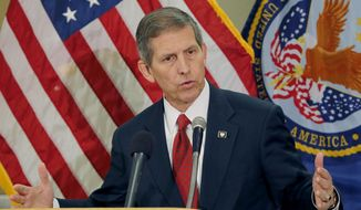 ** FILE ** Acting Secretary of Veterans Affairs Sloan Gibson speaks, Thursday, June 5, 2014, in Phoenix. It was his first visit to Phoenix since taking over the agency amid an investigation that found 1,700 veterans were kept off the official waiting list for care at the troubled Arizona hospital. (AP Photo/Matt York)