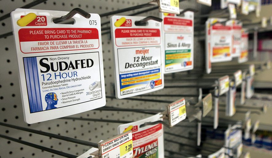 This Dec. 13, 2005, file photo, shows product identification cards for medicines containing pseudoephedrine displayed at a Meijer store in Roseville, Mich. (AP Photo/Paul Sancya)