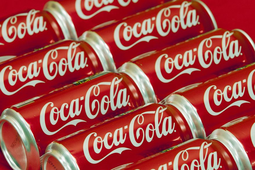 This July 15, 2013 file photo shows cans of Coca-Cola in Doral, Fla. Coca-Cola is taking on obesity, this time with an online video showing how fun it could be to burn off the 140 calories in a can of its soda. (AP Photo/Wilfredo Lee, File)