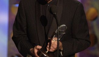 FILE - In this Monday, Oct. 27, 2003 file photo, Casey Kasem accepts a radio icon award during the Radio Music Awards in Las Vegas. On Friday, June 6, 2014, Kasem was in critical condition with an infected bedsore at a Washington state hospital, as his daughter and wife headed to court for another hearing in a dispute over his care. (AP Photo/Joe Cavaretta)