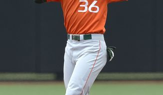 Miami's Dale Carey reacts after being called out while trying to steal second base during the fifth inning of an NCAA college baseball tournament regional game against Oklahoma State, Sunday, June 2, 2013, in Louisville, Ky. Oklahoma State defeated Miami 7-1. (AP Photo/Timothy D. Easley)