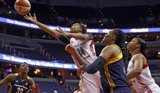 Washington Mystics guard Tierra Ruffin-Pratt (14) shoots between Indiana Fever forwards Natasha Howard (33) and Erlana Larkins (2) during the first half of a WNBA basketball game Friday, June 6, 2014 in Washington.  (AP Photo/Alex Brandon) **FILE**