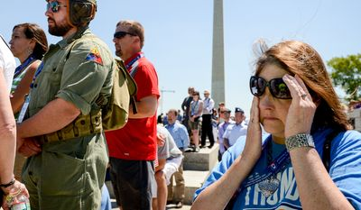 Rhonda Lyon of Choctaw, Okla., right, wipes tears from her eyes as she listens to Gen. Dwight D. Eisenhower's granddaughter Susan Eisenhower speak during a 70th anniversary commemoration ceremony of D-Day at the National World War II Memorial on the National Mall, Washington, D.C., Friday, June 6, 2014. (Andrew Harnik/The Washington Times)