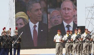 A large screen shows a picture of  Russian President Vladimir Putin, right, and U.S. President Barack Obama during the commemoration of the 70th anniversary of the D-Day in Ouistreham, western France, Friday, June 6, 2014. World leaders and veterans gathered by the beaches of Normandy on Friday to mark the 70th anniversary of World War Two's D-Day landings. (AP Photo/Christophe Ena, Pool)