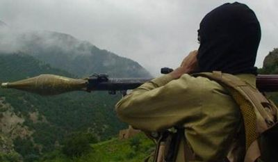 ** FILE ** A Pakistani Taliban militant holds a rocket-propelled grenade in the tribal region of Waziristan, Pakistan, a stronghold of the Haqqani network. (Associated Press)