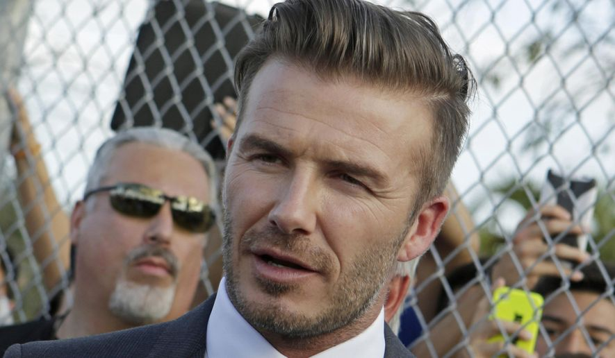 Retired soccer player David Beckham talks to fans during a visit at Kendall Soccer Park as he greets South Florida soccer fans and players in Miami in this Wednesday, Feb. 5, 2014, file photo. (AP Photo/Alan Diaz) ** FILE **