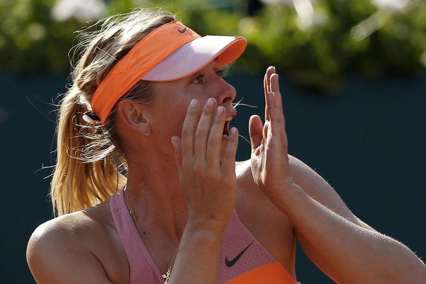 Russia's Maria Sharapova realizes she won the final of the French Open tennis tournament against Romania's Simona Halep at the Roland Garros stadium, in Paris, France, Saturday, June 7, 2014. Sharapova won in three sets 6-4, 6-7, 6-4. (AP Photo/Darko Vojinovic)