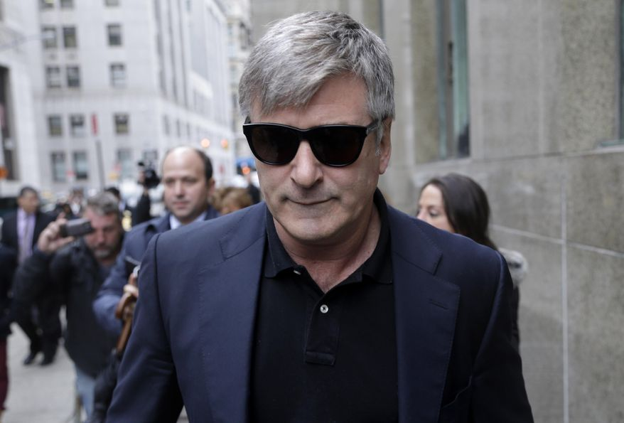 ** FILE ** In this Nov. 12, 2013, file photo, actor Alec Baldwin leaves court in New York. (AP Photo/Seth Wenig, File)