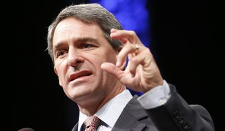 ** FILE ** Former Virginia Attorney General Ken Cuccinelli gestures as he addresses the Virginia GOP Convention in Roanoke, Va., Saturday, June 7, 2014. (AP Photo/Steve Helber)