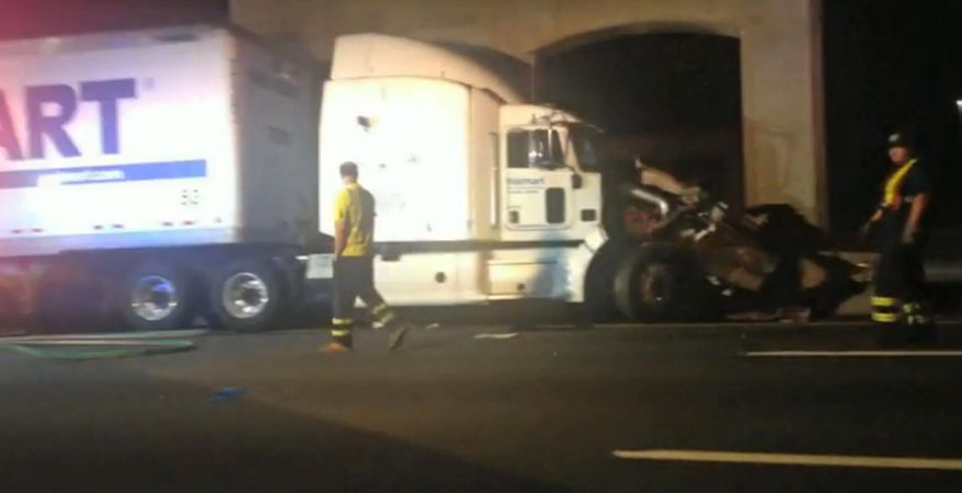 """In this image from video the Wal-Mart truck involved in the crash of the limousine bus carrying Tracy Morgan and six other people is seen early Saturday morning June 7, 2014 on the New Jersey Turnpike at the accident scene. Morgan remained hospitalized as state and federal officials continued their investigation of the six-vehicle crash on the New Jersey Turnpike that took the life of a Morgan friend and left two others seriously injured, authorities say. Wal-Mart President Bill Simon said in a statement a Wal-Mart truck was involved and that the company """"will take full responsibility"""" if authorities determine that its truck caused the accident. (AP Photo/Will Vaultz Photography)"""