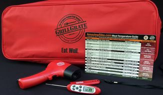 GrillGrates' Championship Steak Grilling Set includes a temperature gun, digital thermometer, meta temperature guide and large carrying case to hold extra barbeque tools. (Photograph by Joseph Szadkowski/The Washington Times)