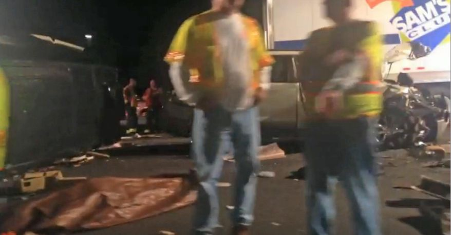 In this image from video the limousine bus carrying Tracy Morgan and six other people lies on it's side, left, as emergency responders work the accident scene early Saturday morning June 7, 2014 on the New Jersey Turnpike. Morgan remained hospitalized as state and federal officials continued their investigation of the six-vehicle crash on the New Jersey Turnpike that took the life of a Morgan friend and left two others seriously injured, authorities say. (AP Photo/Will Vaultz Photography)