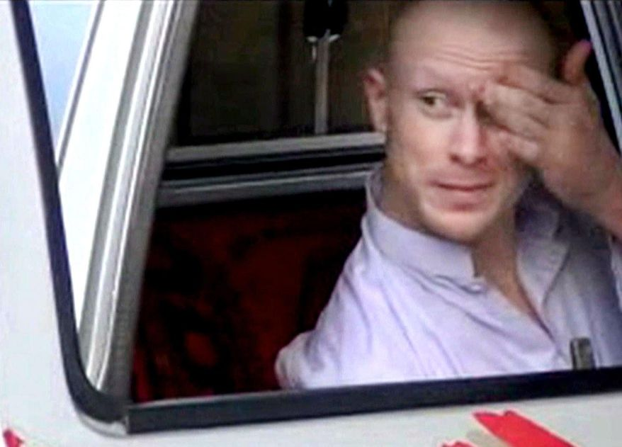 FILE - In this file image taken from video obtained from Voice Of Jihad Website, which has been authenticated based on its contents and other AP reporting, Sgt. Bowe Bergdahl, sits in a vehicle guarded by the Taliban in eastern Afghanistan. Bergdahl was freed by the Taliban on May 31, 2014, in exchange for five Afghan detainees held in the U.S. prison at Guantanamo Bay, Cuba. Two American values, never leave a man behind and never negotiate with terrorists, collided in the Bergdahl calamity with each ethos running deep in the American conscience. (AP Photo/Voice Of Jihad Website via AP video, File)