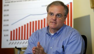 U.S. Sen. Mark Pryor participates in a discussion about increasins college costs and student loans in Little Rock, Ark., Thursday, May29, 2014. (AP Photo/Danny Johnston)