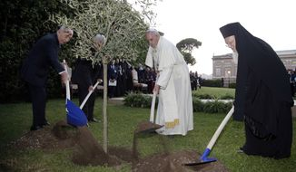 ** FILE ** Pope Francis plants an olive tree with Israel's President Shimon Peres, left, Palestinian President Mahmoud Abbas, second from left, and Ecumenical Patriarch Bartholomew I, right, in a sign of peace during an evening of peace prayers in the Vatican gardens, Sunday, June 8, 2014. (AP Photo/Max Rossi, Pool)