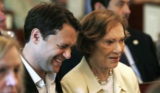 Georgia Democratic gubernatorial candidate Jason Carter sits with his grandmother former first lady Rosalynn Carter during a church service in Plains, Ga, Sunday, June 8, 2014. The younger Carter is hoping that a large fundraising effort this weekend will help his campaign. (AP Photo/John Bazemore)