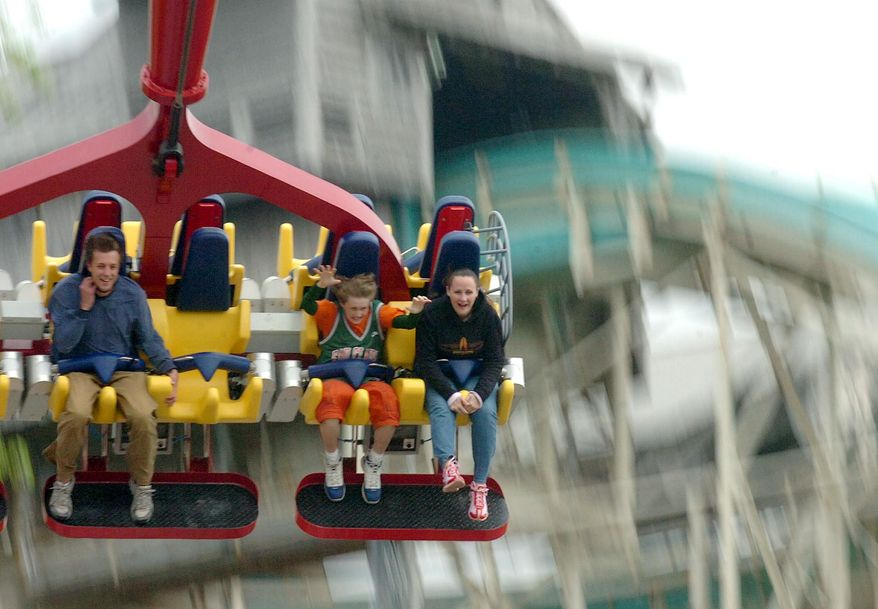 FILE - In this Thursday, May 4, 2006, file photo, people ride the Skyhawk, at Cedar Point amusement park, in Sandusky, Ohio. Park officials closed Cedar Point on Saturday, June 7, 2014, after a water main break in the city of Sandusky disrupted its primary water supply. (AP Photo/Sandusky Register, Jason Werling, File)
