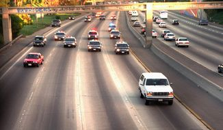 ** FILE ** In this June 17, 1994 file photo, a white Ford Bronco, driven by Al Cowlings carrying O.J. Simpson, is trailed by Los Angeles police cars as it travels on a Southern California freeway in Los Angeles. Cowlings and Simpson led authorities on a chase after Simpson was charged with two counts of murder in the deaths of his ex-wife, Nicole Brown Simpson, and her friend, Ron Goldman. (AP Photo/Joseph Villarin, File)