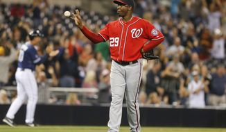 Washington Nationals closer Rafael Soriano snatches at a new ball after surrendering a game tying home run to San Diego Padres' Yonder Alonso during the bottom of the ninth inning of a baseball game Saturday June 7, 2014, in San Diego. (AP Photo/Lenny Ignelzi)