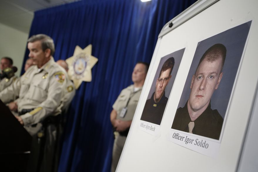 Sheriff Doug Gillespie, left, speaks at a news conference on the shooting of two Las Vegas Metropolitan Police Department officers Sunday, June 8, 2014 in Las Vegas. The two officer killed were Alyn Beck and Igor Soldo. (AP Photo/John Locher)