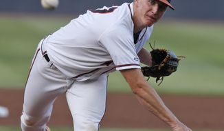 Virginia pitcher Josh Sborz (27) tosses a pitch during the first inning of an NCAA Super Regional baseball game in Charlottesville, Va., Monday, June 9, 2014. (AP Photo/Steve Helber)