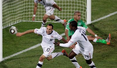 Landon Donovan (10) celebrates with teammates Clint Dempsey (left) and Edson Buddle after scoring a goal against Algeria during the 2010 World Cup. (associated press)