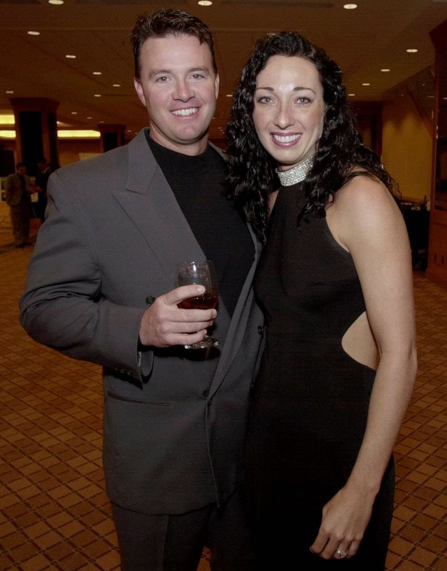 Olympic swimmer Amy Van Dyken, right, and Denver Broncos punter Tom Rouen pose before going into the Colorado Sports Hall of Fame dinner in Denver, Thursday, March 1, 2001, where Van Dyken and five other Colorado sports figures were honored. (AP Photo/David Zalubowski)