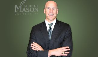 George Mason named Brad Edwards, a former Washington Redskins safety, its new athletic director on June 2, 2014. (George Mason Athletics photo)