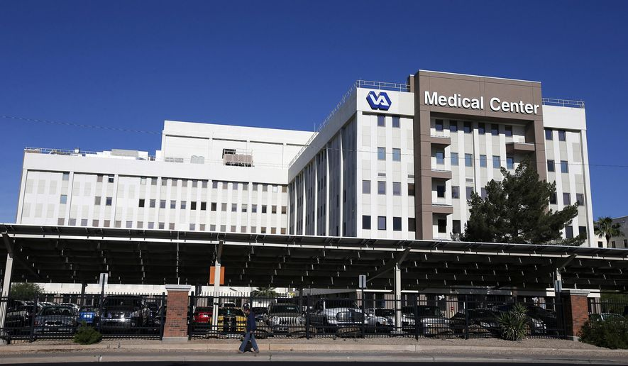 ** FILE ** This April 28, 2014, file photos shows the Phoenix VA Health Care Center in Phoenix. The Veterans Affairs Department says more than 57,000 patients are still waiting for initial medical appointments at VA hospitals and clinics 90 days or more after requesting them. An additional 64,000 who enrolled in the VA health care system over the past 10 years have never had appointments. (AP Photo/Ross D. Franklin, File)