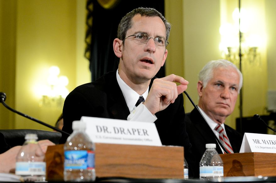 Veteran Affairs Undersecretary for Health for Administrative Operations Assistant Deputy Philip Matkovsky, left, and Acting Veterans Affairs Inspector General Richard Griffin, right, testifies at a House Veterans' Affairs Committee hearing on Capitol Hill, Washington, D.C., Monday, June 9, 2014. (Andrew Harnik/The Washington Times)