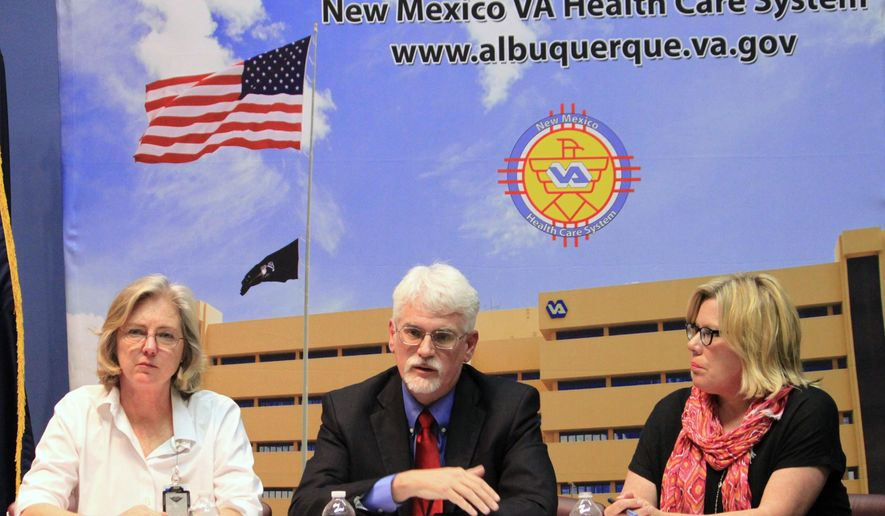 New Mexico Veterans Affairs health care system interim director James Robbins, center, talks about patient wait times, while Dr. Meghan Gerety, left, and associate director Pamela Crowell listen during a news conference in Albuquerque, N.M., on Tuesday, June 10, 2014. VA officials acknowledged that a recent audit highlights problems with wait times for veterans in New Mexico. (AP Photo/Susan Montoya Bryan)