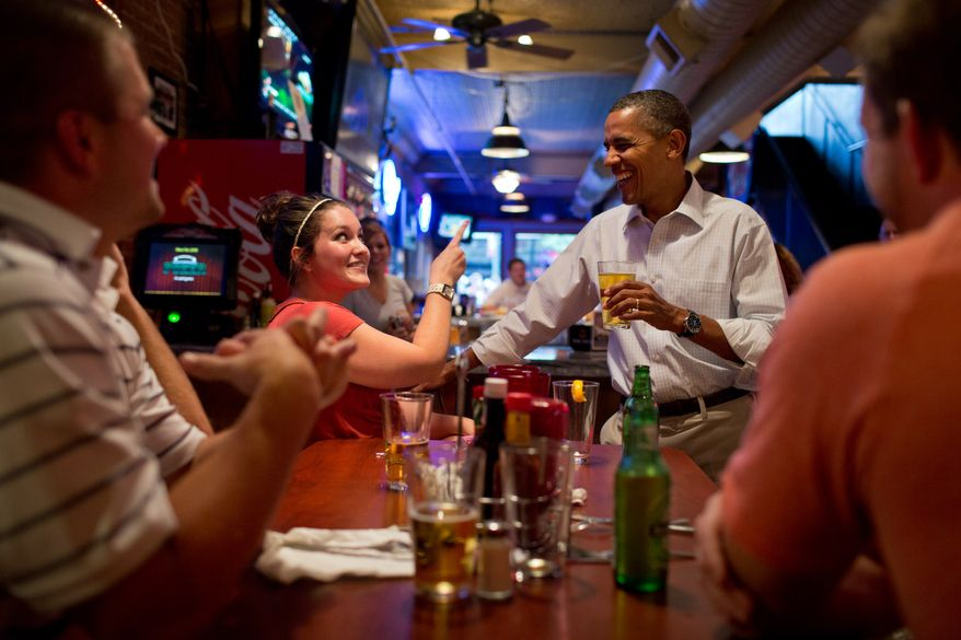 President Barack Obama has a beer with patrons at the Pump Haus Pub and Grill in Waterloo, Iowa, Aug. 14, 2012. (Official White House Photo by Pete Souza)  This official White House photograph is being made available only for publication by news organizations and/or for personal use printing by the subject(s) of the photograph. The photograph may not be manipulated in any way and may not be used in commercial or political materials, advertisements, emails, products, promotions that in any way suggests approval or endorsement of the President, the First Family, or the White House.Ê
