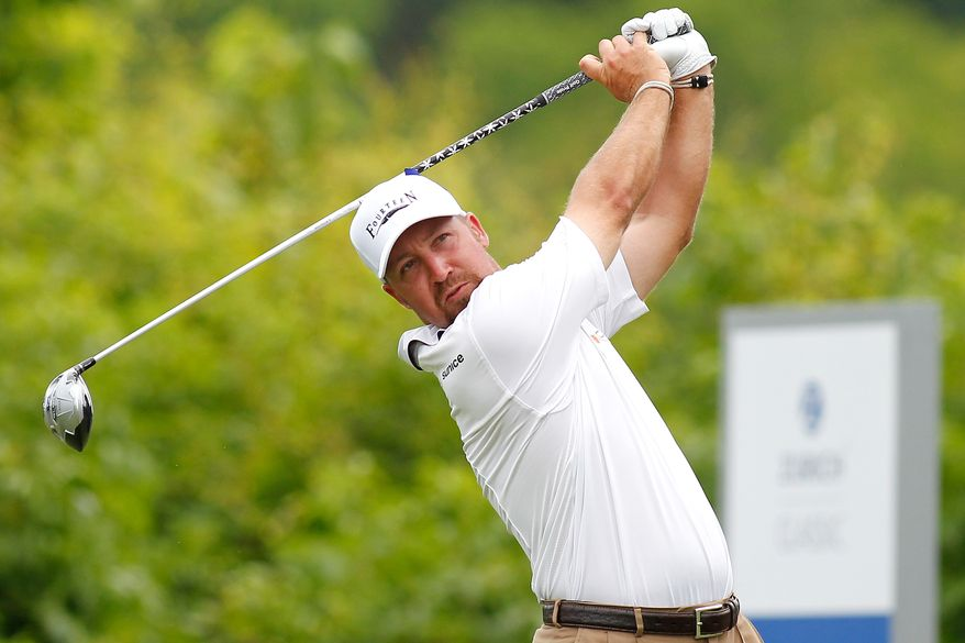 Chad Collins tees off on the 2nd hole during the third round of the PGA Zurich Classic golf tournament at TPC Louisiana in Avondale, La., Saturday, April 26, 2014. (AP Photo/Jonathan Bachman)