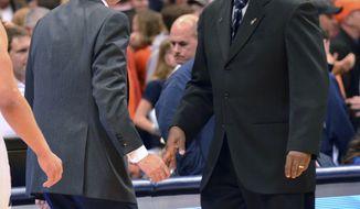 Georgetown coach John Thompson III, right, shakes hands with Syracuse coach Jim Boeheim after Georgetown won 57-46 in an NCAA college basketball game in Syracuse, N.Y., Saturday, Feb. 23, 2013. (AP Photo/Kevin Rivoli)