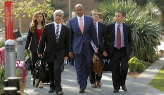 **FILE** Attorneys Theodore Boutrous (second from left) and Marcellus McRae (third from left), representing nine California public school students who are suing the state to abolish its laws on teacher tenure, seniority, and other protections, walk to a news conference outside the Los Angeles Superior Court on Jan. 27, 2014. Their case Vergara v. California is the latest battle in a growing nationwide challenge to union-backed protections for teachers. (Associated Press)